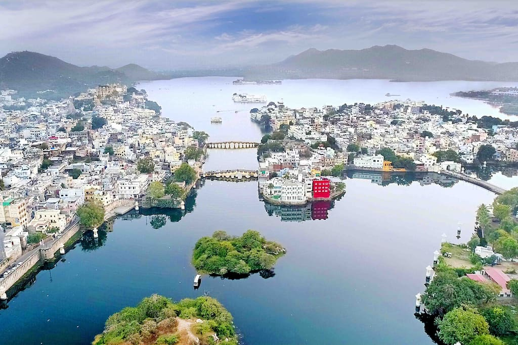 """The RED lake house (named """"oolala"""") right in the center of Udaipur, Rajasthan—yes, that's where you'll stay. A lake house in the lake city."""