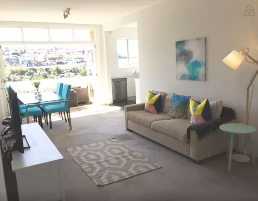 Bright and modern lounge room, perfect for relaxing after a hard day at the beach.