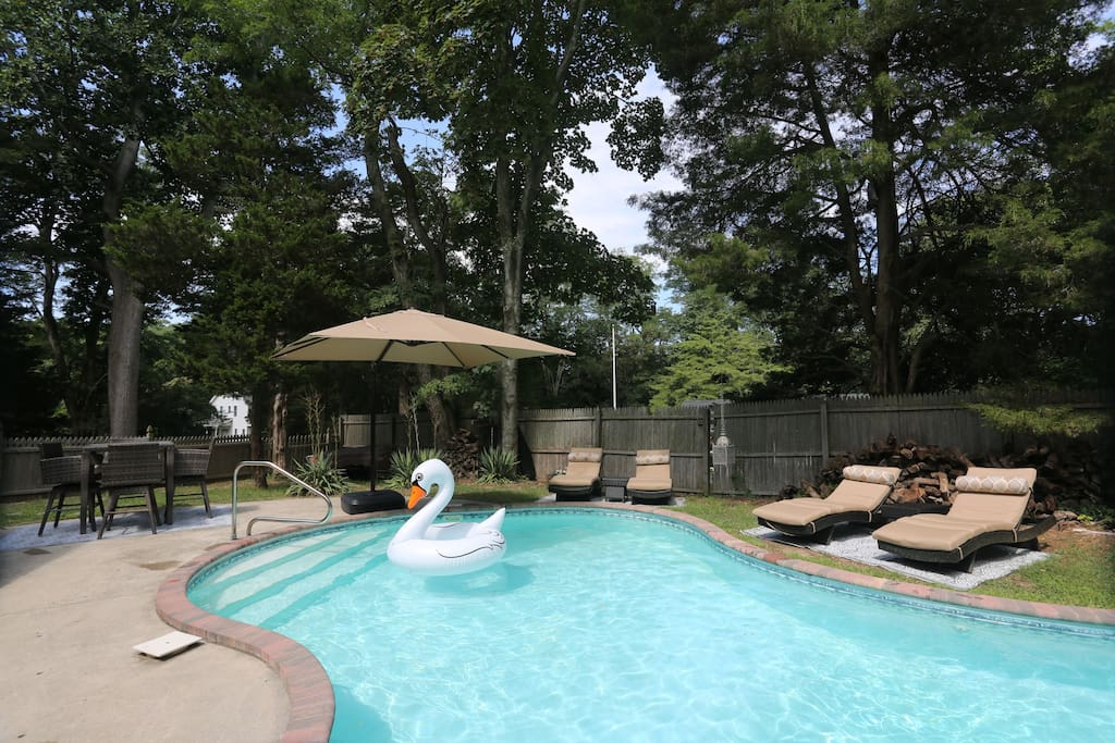 organic shaped pool with lounge chairs and bar