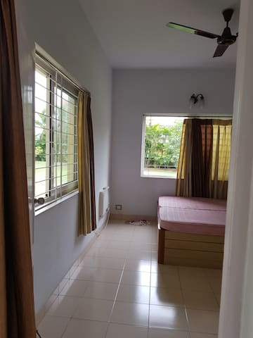 Ground floor double  bedroom  wit full size cupboard and bed side table