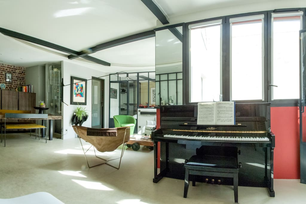 View from the entrance of the apartment with its upright piano