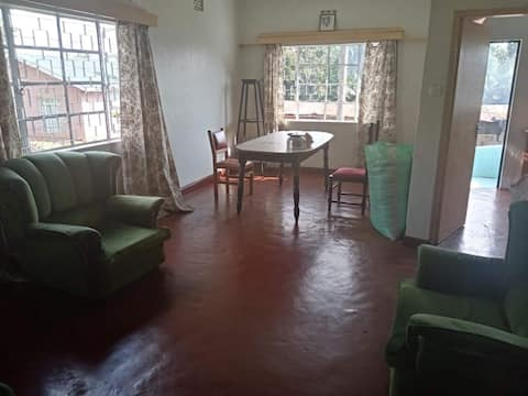Cheerful 2-bedroom residential home with free parking on premises