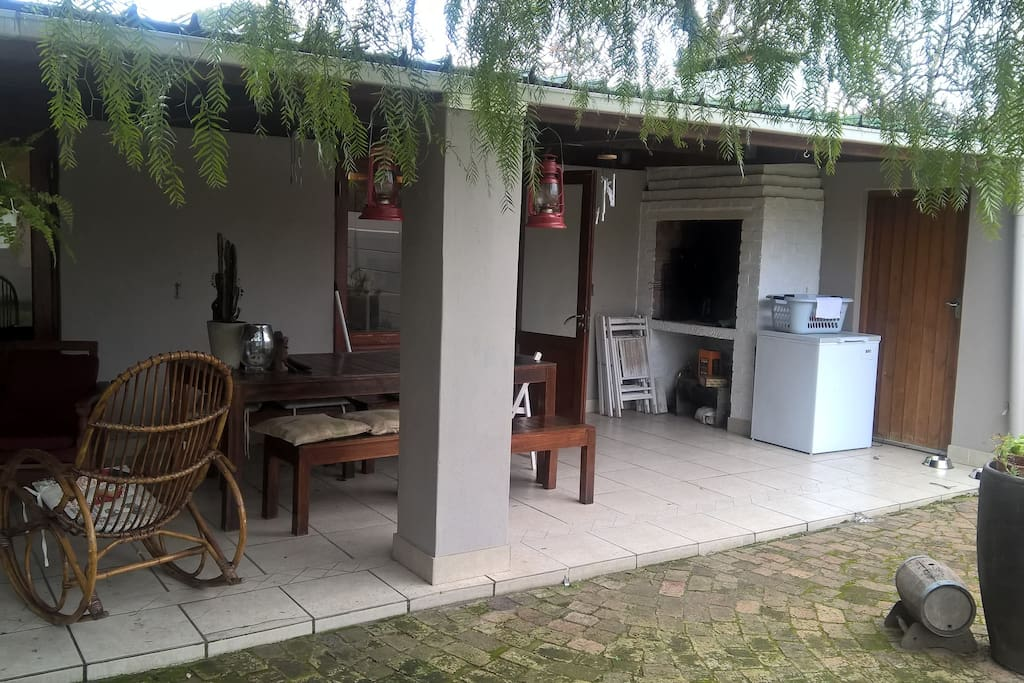 The patio and outside eating area. Washing machine for guest use in the utility room to the right.