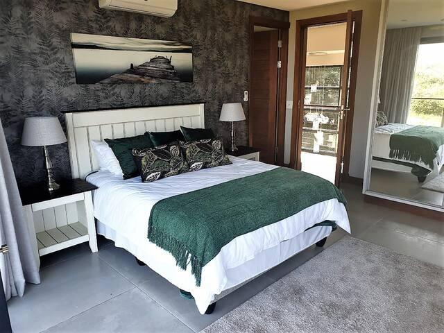 Bedroom #2 - queen size bed; sea view; balcony; aircon & roof fan; en suite bathroom