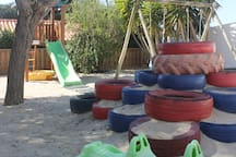 Playgarden with trampoline and playtower for the kids.