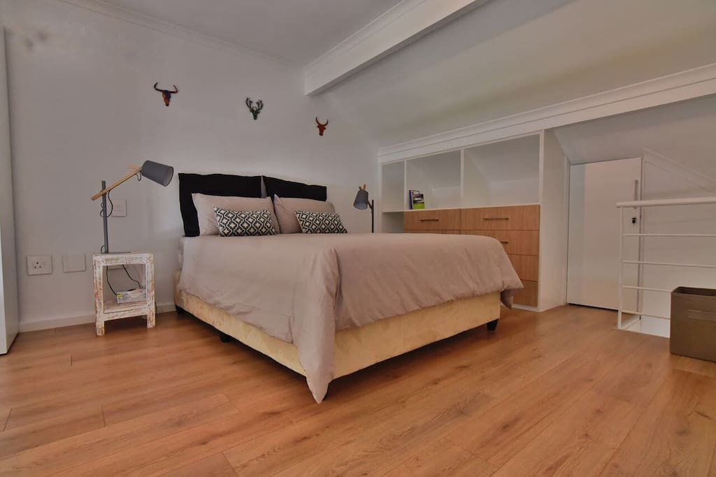 Beautiful airy loft bedroom with plenty of space.