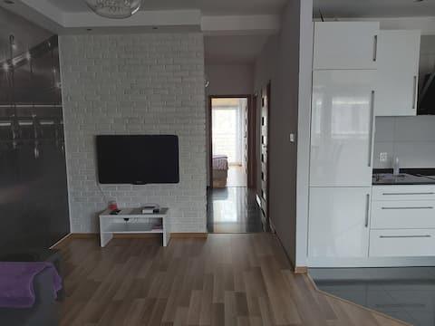 Komfortowy apartament 67m2  dwa balkony 1-4 osób