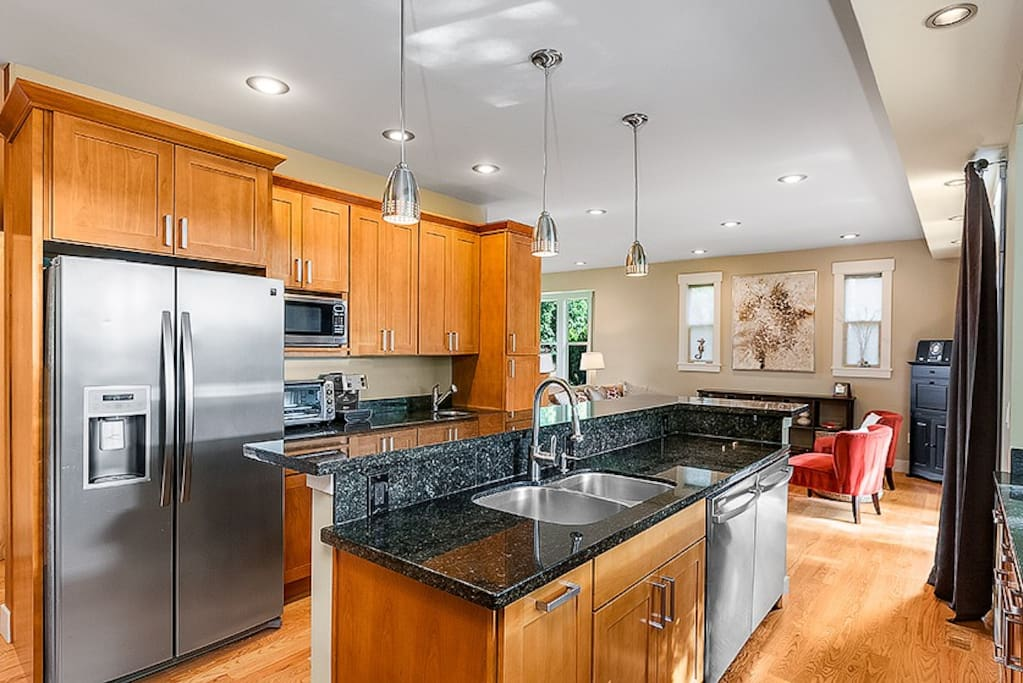 Beautiful modern kitchen with lots of granite counter space and all the kitchen gear you'll need