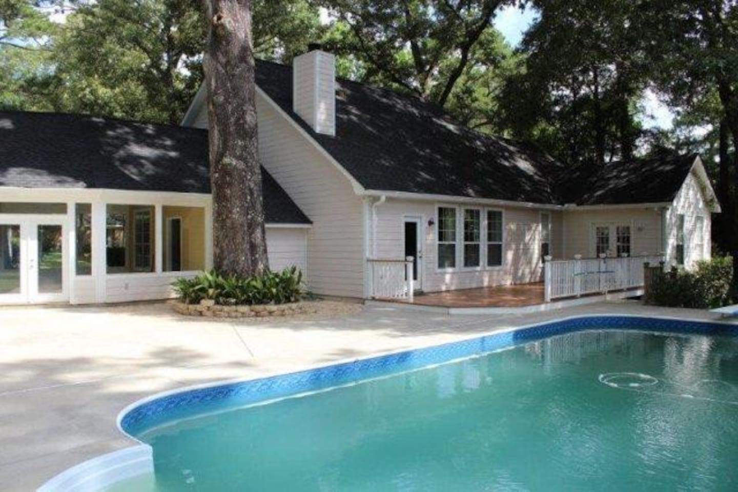 Half acre property with screened porch and salt water pool.
