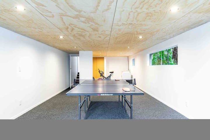 Games room featuring table tennis, exercise equipment and laundry facilities.