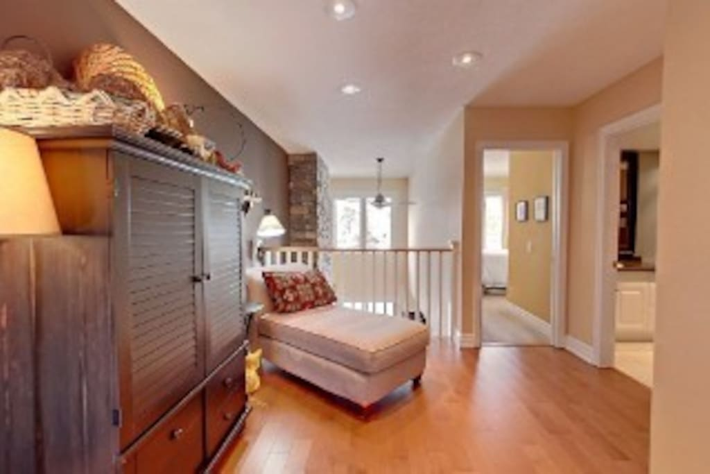 Relax on this chaise lounger while reading a book . Located on 2nd floor outside master bedroom