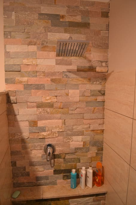 new shower with stone wall