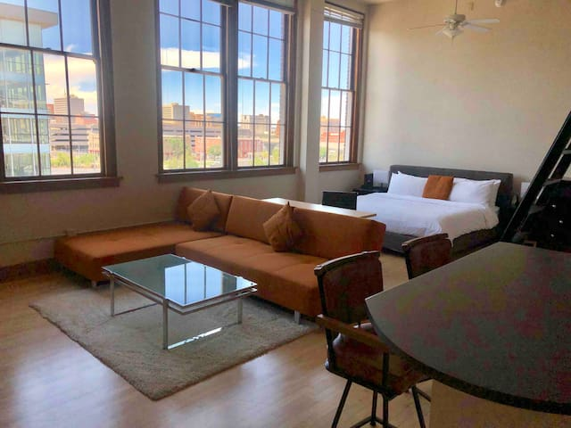 9Ft Windows with views of the Albuquerque Skyline.