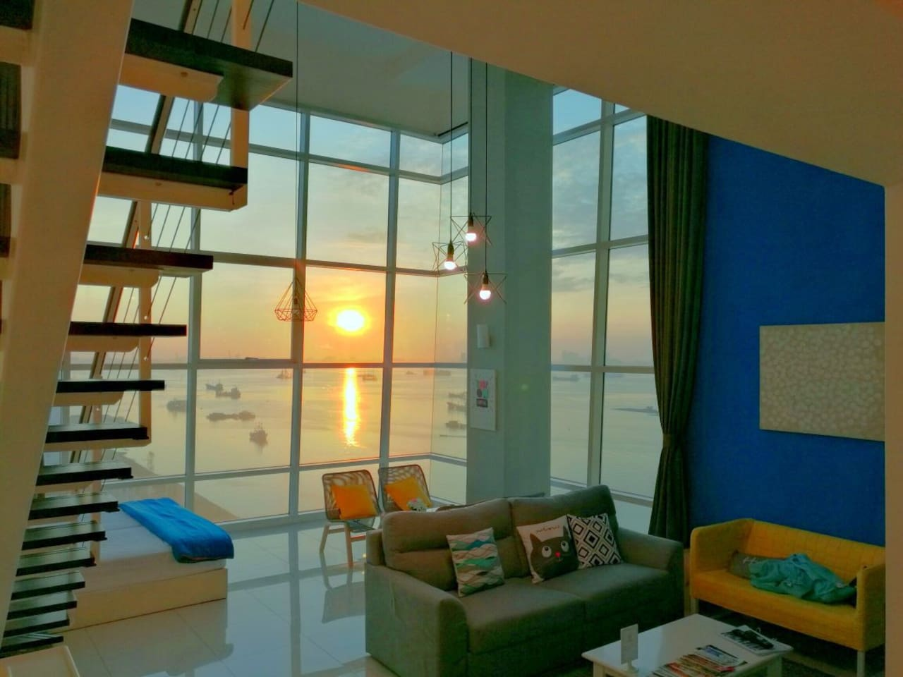 Amazing sunrise and full seaview from the house! Enjoy the nature seaview and the changing sky from our duplex super high 2 storey ceiling to floor glass windows.