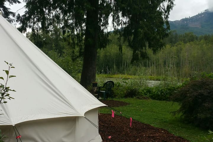 Glamping at the Oasis on the river, pet friendly.