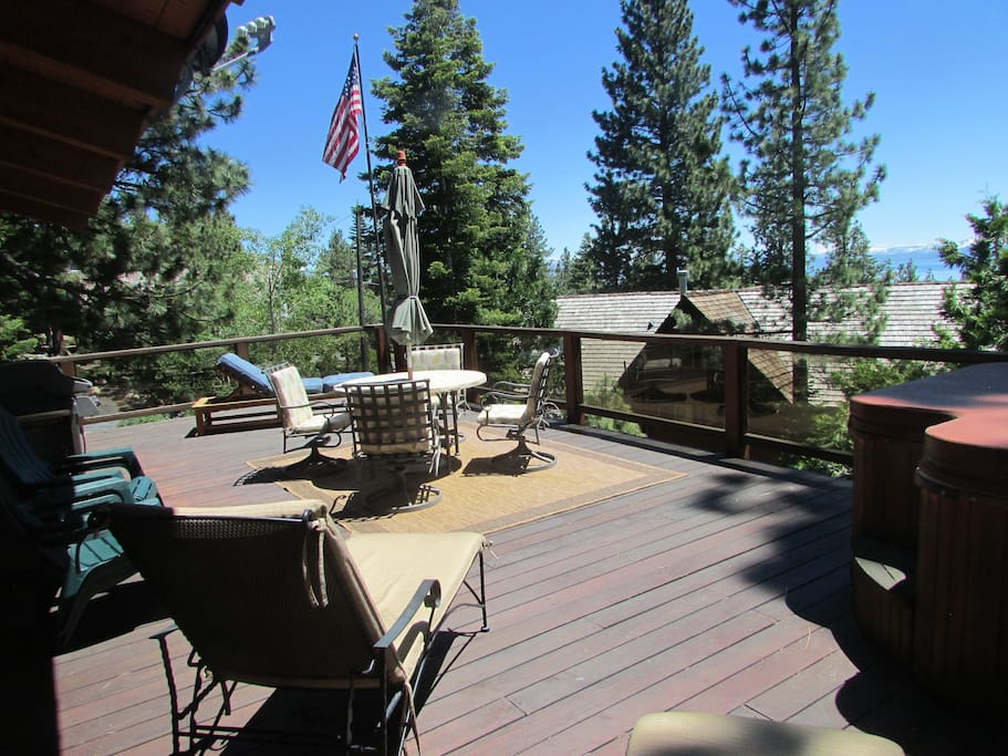big deck with lake view, hot tub and gas BBQ