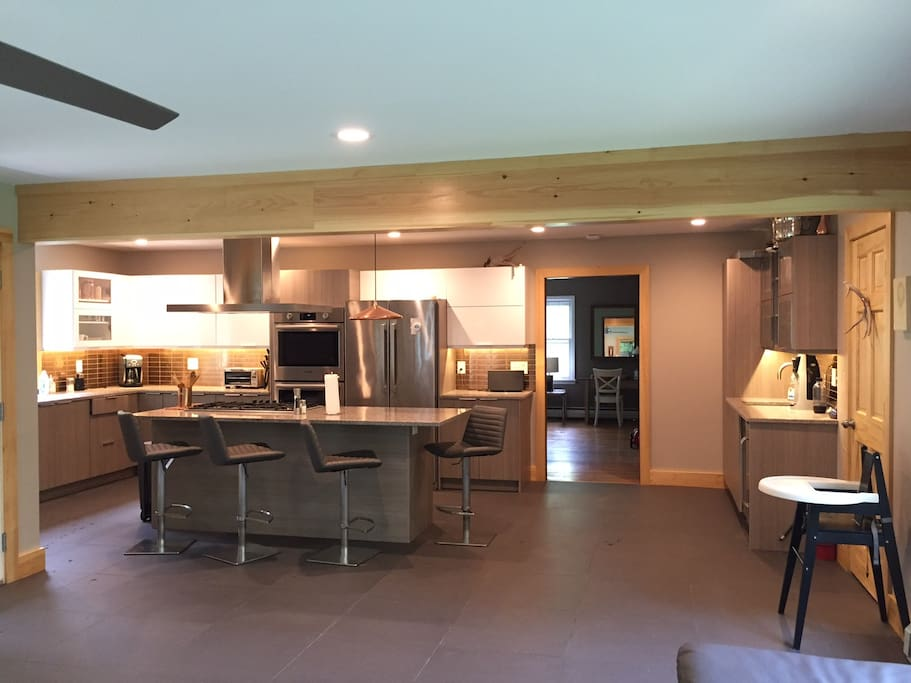 Chef's kitchen! Opens to family room / back porch.