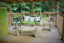 Darling porch, nice for a cold drink on a hot day or a hot chocolate in Autumn.