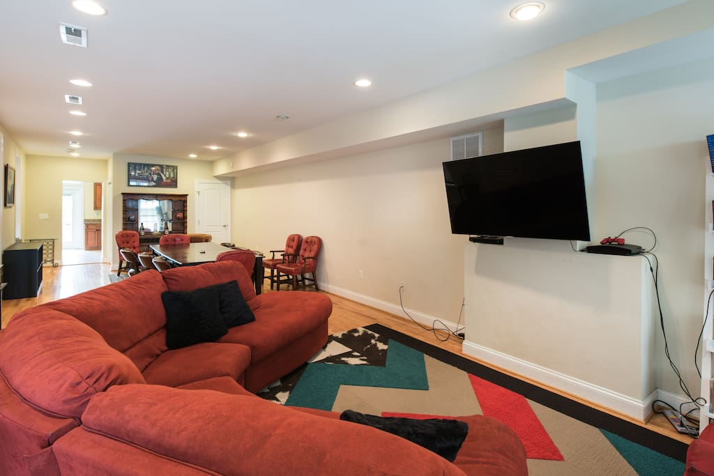 Big, open floor plan with living room HD TV, PS3, board games, DVD library, and dining table for 10.