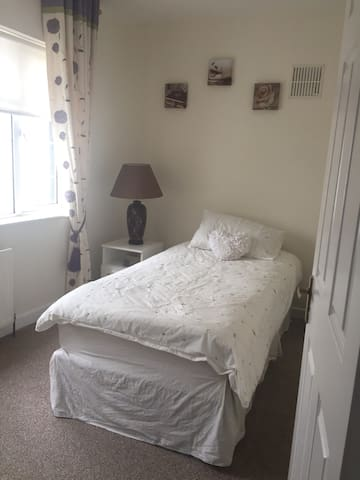 Cosy single room in a family home