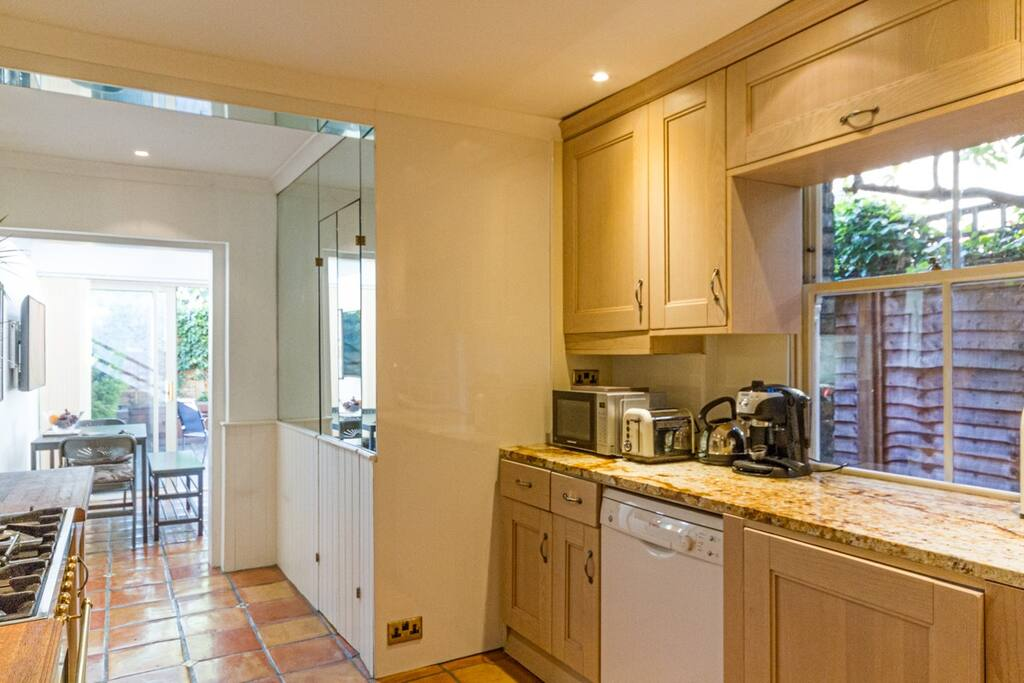 Kitchen leading to sitting room and deck area