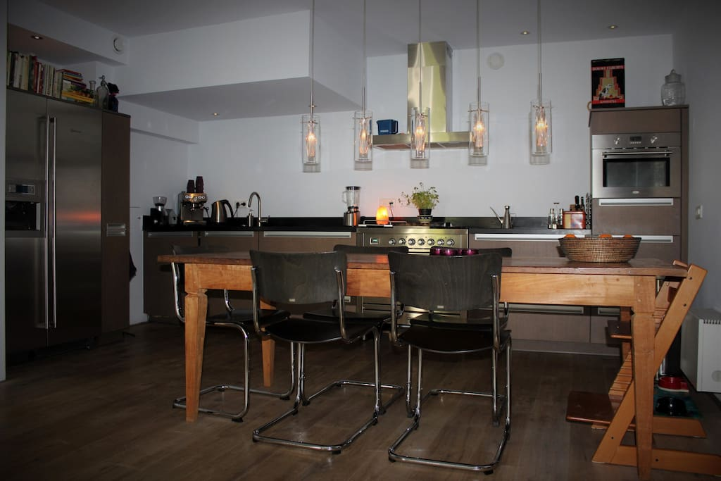 Modern open kitchen with large dining table