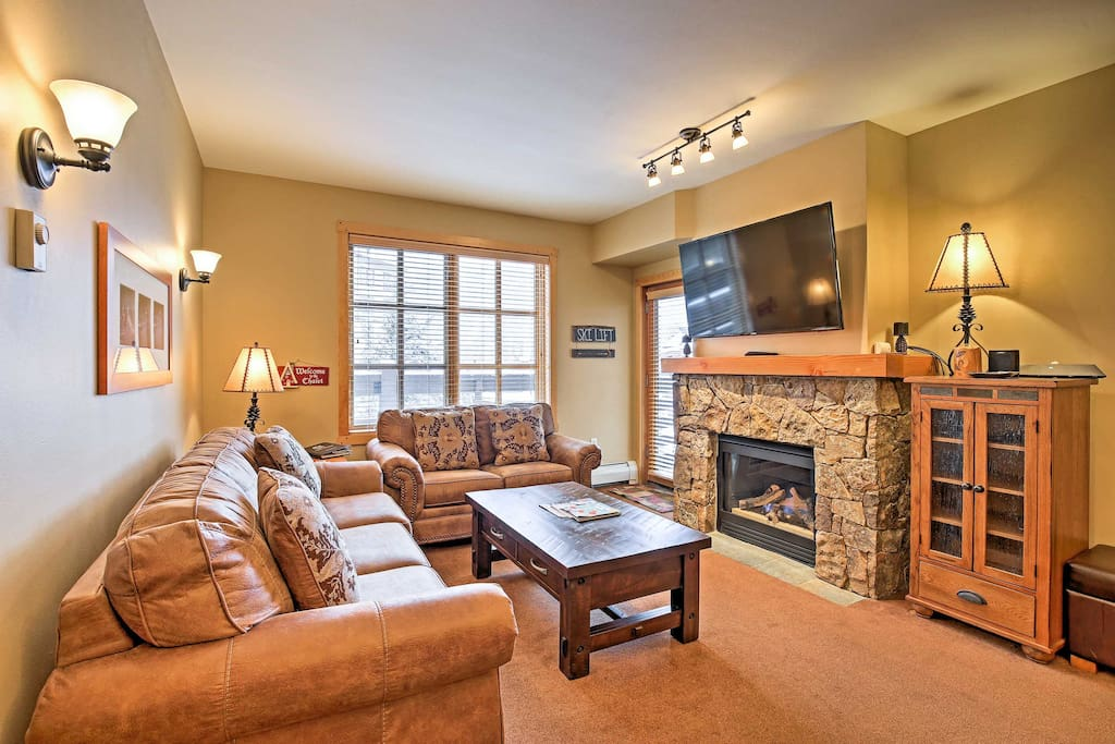 The stone gas fireplace anchors the living space.