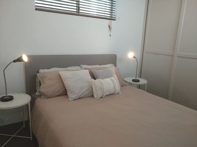 The master bedroom comes with a queen bed and two side tables and a table lamp each. This fully air-conditioned ensuite bedroom comes with a built in wardrobe.  We provide ironing board, iron, hangers, hairdryer, clean bath towels and hand towels.