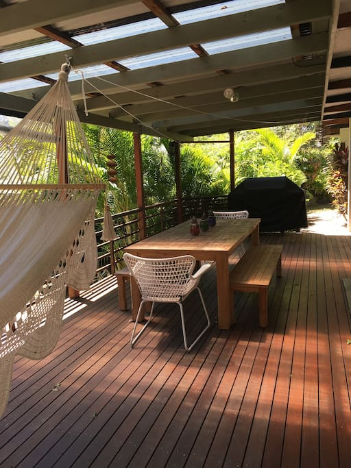 Beautiful open deck with large outdoor table to enjoy a BBQ and socialize