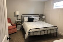 Main bedroom with a Brand new Queen bed and bed frame.