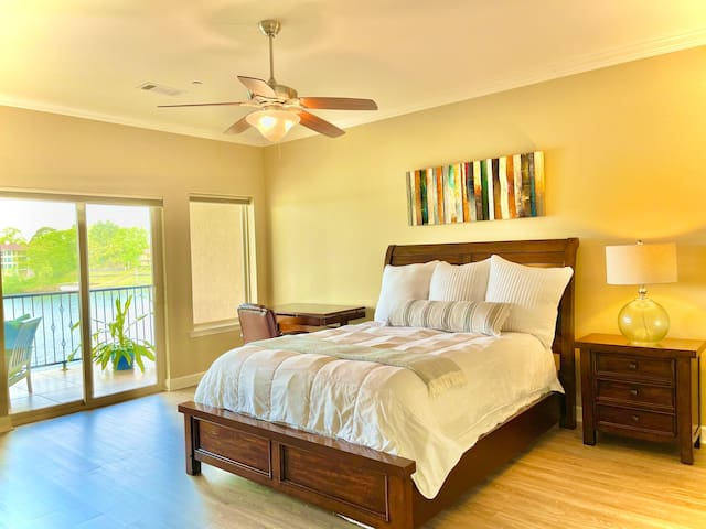 The spacious master bedroom has private access to the balcony