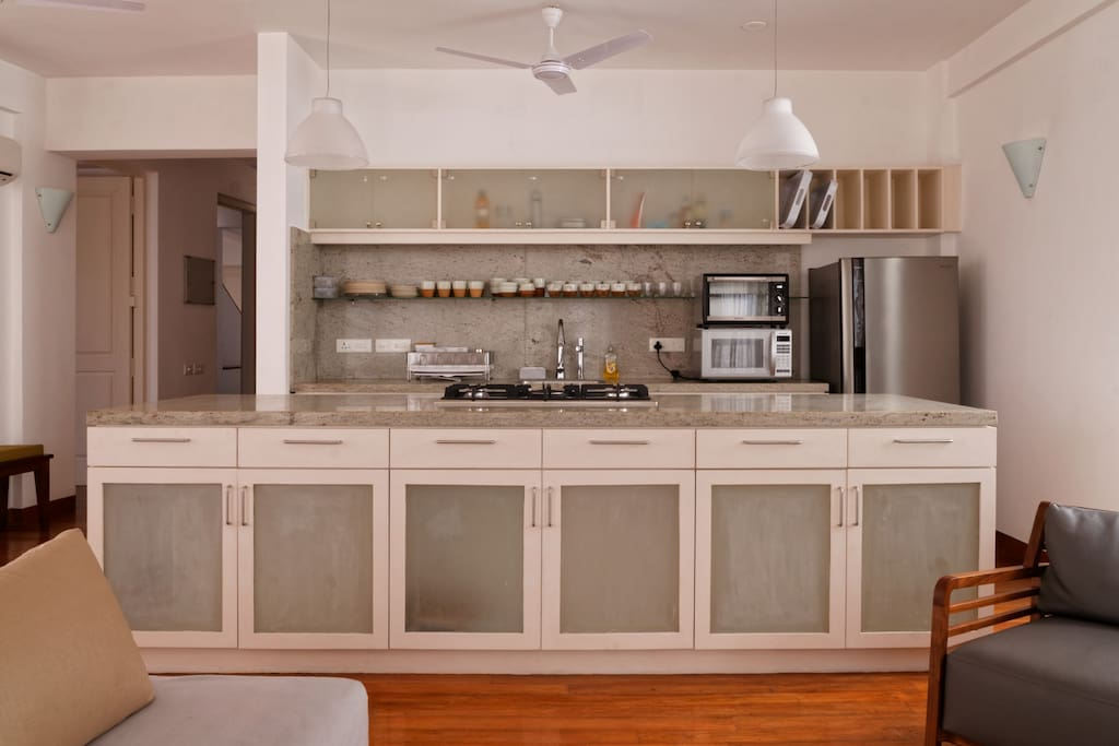 Modern Kitchen with microwave and toaster over - high end Kichen pots and pans