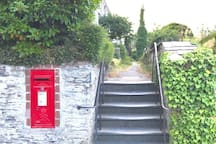 Look out for these steps & post box near the top of Whiterock Road, on the right. Whiterock Terrace (where we live) runs off  Whiterock Road, up these steps.