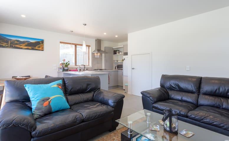 Ground level: lounge, kitchen, dining, 1 bedroom, laundry