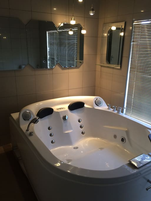 Shared bathroom with shower and Jacuzzi