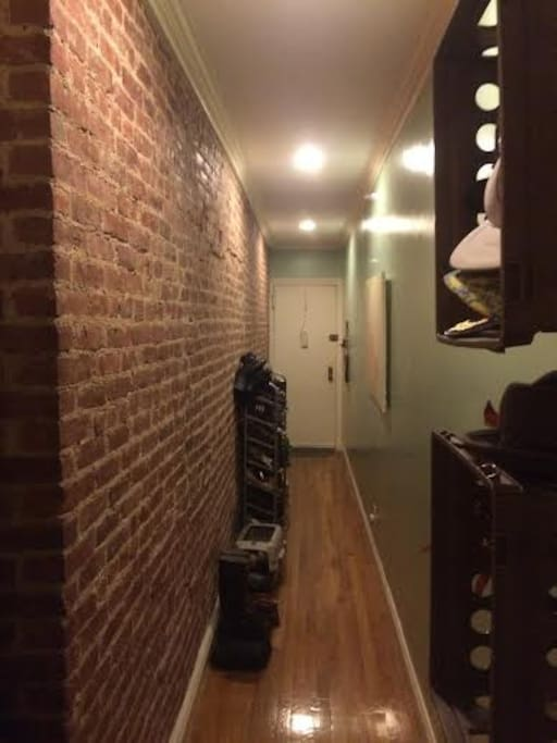 exposed brick entrance hallway.