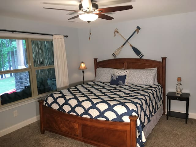 Huge master suite with spectacular views of the lake. It has an attached bathroom, king-sized bed, full-size couch, walk-in closet, & flat screen tv w/dvd player.