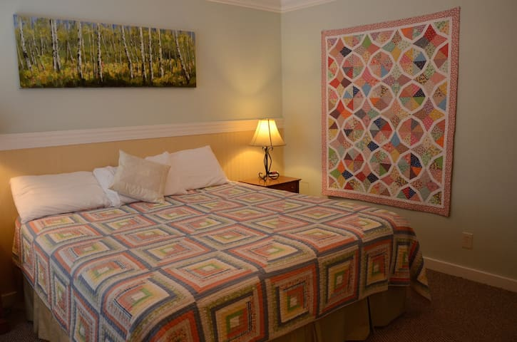 Another lovely bedroom with king bed