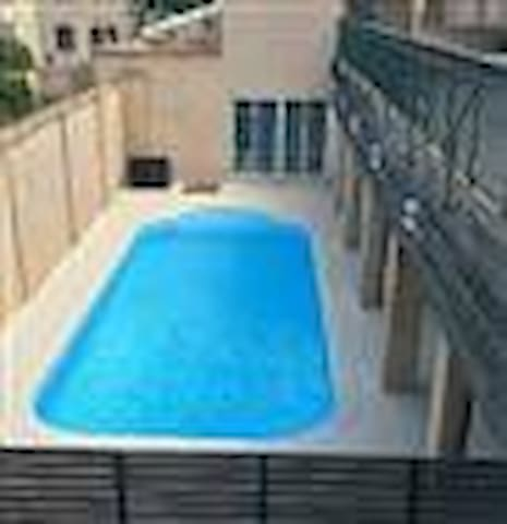 """A poor shot, to be replaced. During """"the season"""" sun loungers* are placed around the pool which is for the exclusive use of residents and their guests. * Whilst there are several, use is on a first come, first served basis."""