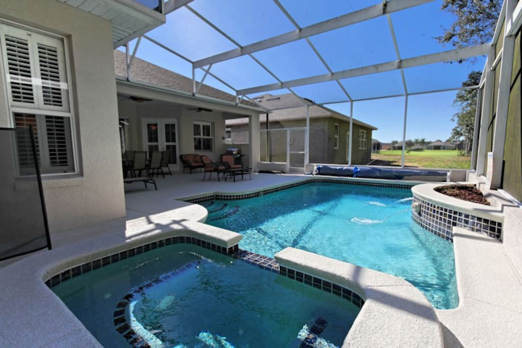 The property backs onto a green space offering privacy in the pool and patio areas. The pool can be heated and is enclosed with a screened lanai with a covered patio area for dining or to retreat from the sun. There is also an extended lanai section for those who want to soak up extra sun!
