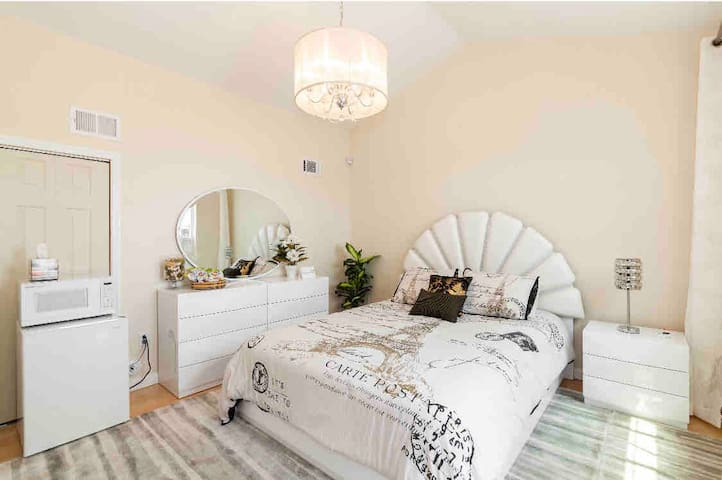 """Beautiful bedroom on top of the house.  We call this room a """"Lighthouse"""" it has the best views of the beach and the neighborhood!"""