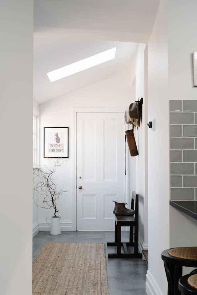Stylish mudroom at the back entrance to Raffah House