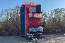 Porta potty is at front left corner of the property. There are large jugs filled with water on the shelf next to the Porta potty for washing up, brushing teeth, etc. Full service showers can be taken 10 miles away at the Terlingua Ranch Lodge