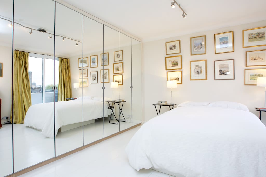 The large bedroom has a King sized bed with mirror cupboards to store your belongings.