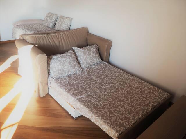 Habitación 4: Gran salón-dormitorio en planta superior.