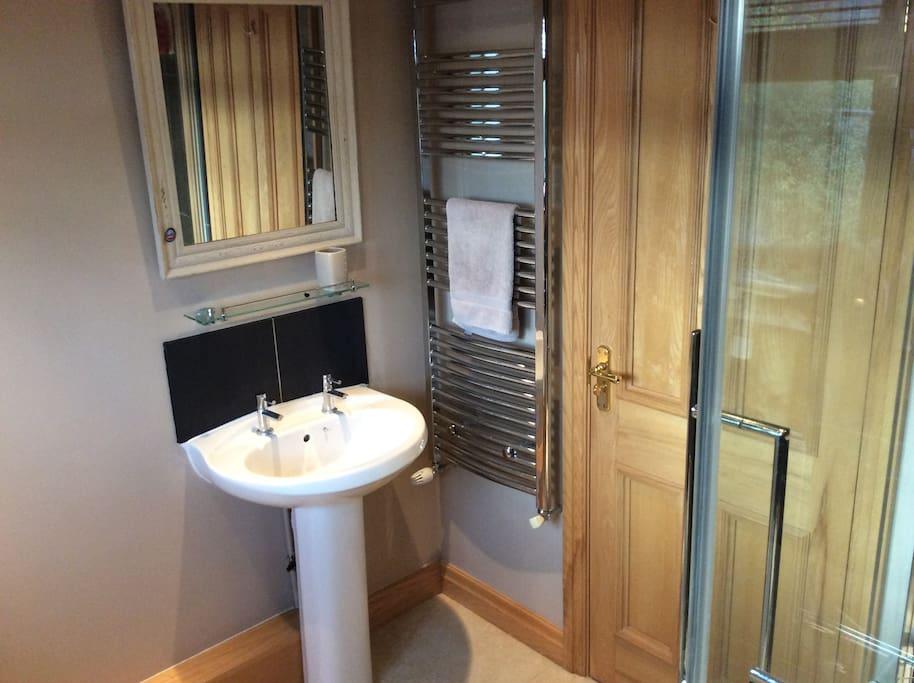 Very warm bathroom with heated towel rail and underfloor heating