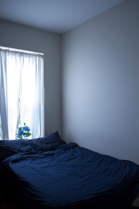The beautiful full-size bed! Blue just like the ocean, also my favorite color! :D
