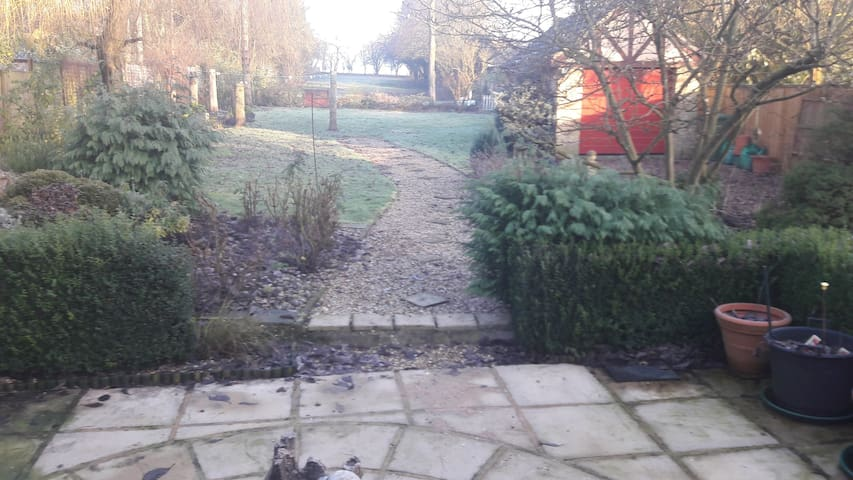Large attractive garden with patio area