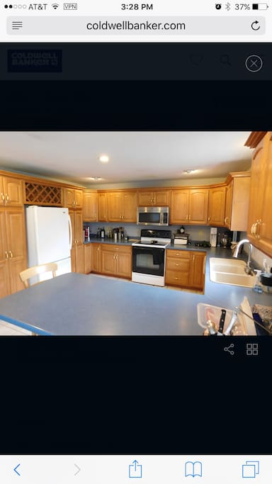 A large kitchen, with a breakfast bar, for friends and family to gather, cook and enjoy good times together.