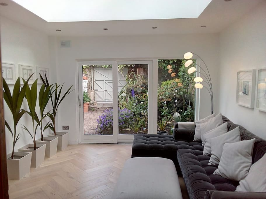 Bright sitting room opening onto walled garden